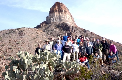 Students at field camp in front of a clay formation.
